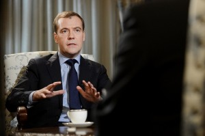 Russia's Prime Minister Dmitry Medvedev (L) speaks during an interview with Agence France Presse in the Gorki outside Moscow.(AFP PHOTO / NATALIA KOLESNIKOVA)
