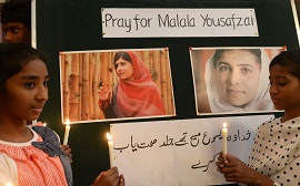 Pakistani Christians attend a prayer service for the recovery of schoolgirl activist Malala Yousafzai at a church in Lahore. (AFP PHOTO / ARIF ALI)