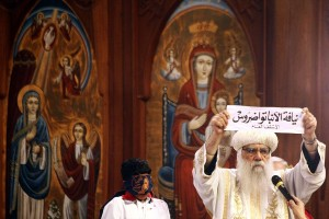 Egyptian caretaker of the Coptic Church Bishop Pachomius shows the ballot bearing the name of Bishop Tawadros in Arabic AFP PHOTO / MAHMUD KHALED