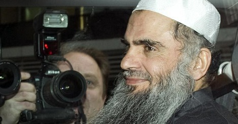 A picture dated April 17, 2012 shows radical cleric Abu Qatada sitting in a car as he is driven away from a Special Immigration Appeals Hearing at the High Court in London to jail after being re-arrested. (AFP PHOTO)