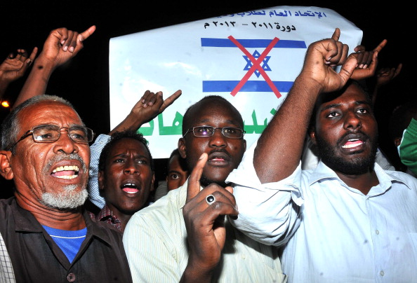 Sudanese demonstrators hold banners and chant anti-Israeli slogans during a protest in Khartoum on October 24, 2012. (EBRAHIM HAMID / AFP / Getty Images)