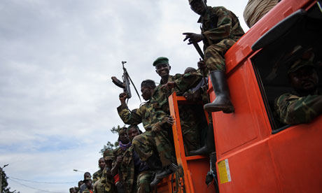 M23 paramilitaries celebrate in the streets after taking Goma. Photograph. (AFP / GETTY IMAGES / Phil Moore)