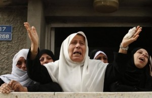 Relatives of an 18-year-old Palestinian civilian mourn his death in the clashes. (AFP / MOHAMED ABED)