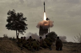 An Israeli defence missile is launched to block incoming rockets from Gaza. (AFP PHOTO / MENAHEM KAHANA)