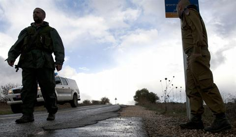 Israeli soldiers stand guard in Alonei Habashan in the Israeli-occupied Golan Heights, on November 11, 2012. (AFP PHOTO / JALAA MAREY)