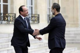 French President Francois Hollande (L) welcomes Syrian opposition chief Ahmed Moaz Al-Khatib in Paris Saturday. (AFP PHOTO / Kenzo Tribouillard)