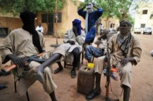 A file picture taken on July 16, 2012 shows fighters of the Islamist group Movement for Oneness and Jihad in West Africa (MUJAO) sitting in the courtyard of the Islamist police station in Gao. (AFP PHOTO)