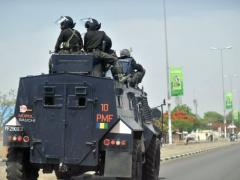 Nigerian police enforcing a curfew in the capital of Bauchi state, northern Nigeria in 2011. (AFP / FILE PHOTO, Tony Karumba)