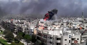 Heavy explosions could be frequently heard in Aleppo and Damascus while warplanes and helicopters flew over the city. ( AFP PHOTO / YOUTUBE)