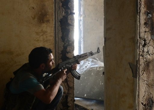 A Syrian rebel aims his weapon during clashes with government forces in the Saif al-Dawla district of the northern city of Aleppo on October 5. (AFP / FILE PHOTO / TAUSEEF MUSTAFA)