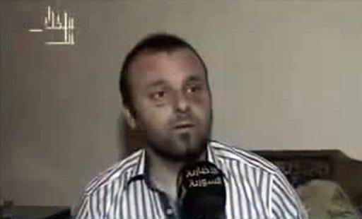 A picture grab from the Syrian Al-Ikhbariya news channel shows Turkish journalist Cuneyt Unal. (AFP PHOTO / AL-IKHBARIYA)