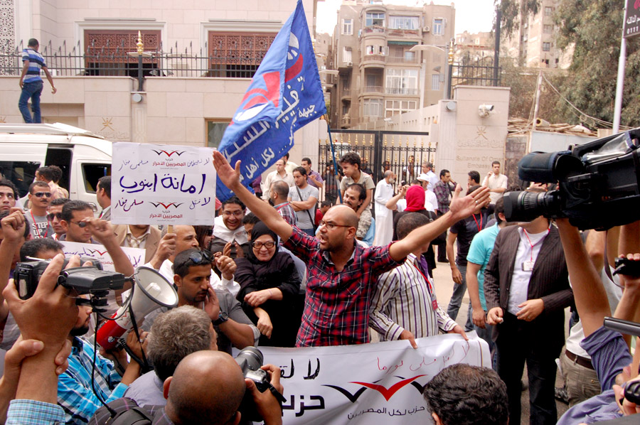 Members of the Free Egyptian Party march through Zamelek calling on President Morsy to take a stance on the violence against Muslims in Myanmar (Photo by Joel Gulhane)