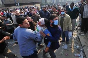 A protester overcome by teargas is carried off to a field hospital on Mohamed Mahmoud Street Hassan Ibrahim