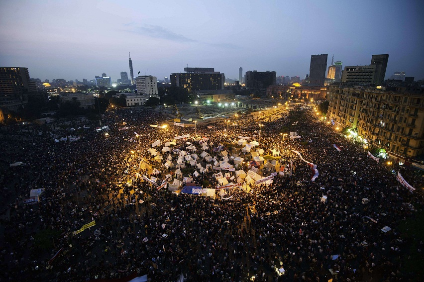 Tens of thousands people take part in a mass rally in Tahrir Square against the decree by President Morsy. The planned demonstrations came a day after Morsy stuck by his controversial decree in a meeting with judges that was aimed at defusing the worst political crisis since his election in June AFP Photo / Gianluigi Guercia