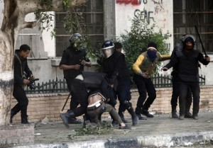 Egyptian riot police detain a man during clashes on Omar Makram street, off Tahrir Square AFP Photo / Mahmoud Khaled
