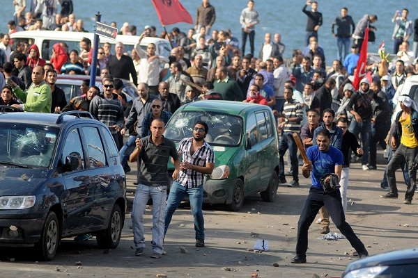 Fighting between supporters and opponents of President Morsy also broke out in Alexandria on the 23 November (File photo) AFP Photo / Stringer