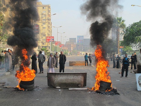 Protesters block Bahr Al-Azam road in Giza, provoking violent confrontations with the security forces last December. (Photo via Mohamed Abla's Facebook page)