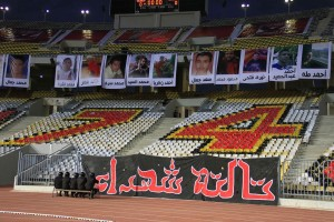 Photos of those killed in the Port Said stadium disaster hang inside Alexandria's Borg El-Arab stadium at the start of an El-Ahly match Mohamed Hamza