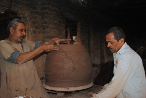 Anwar working on a large pot Abdel-Rahman Sherief