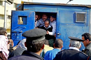 Security forces arrest protesters demonstrating near the house of Prime Minister Hesham Qandil Photo by Mohamed Omar