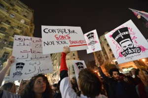 Egyptian protesters hold up placards and shout slogans during a demonstration in Cairo against sexual harassment on February 12, 2013. Egyptian protesters took to the street again to demand an end to sexual violence, as campaigns against the repeated attacks in central Cairo pick up steam. Sexual harassment has long been a problem in Egypt, but recently the violent nature and frequency of the attacks have raised the alarm. AFP PHOTO / KHALED DESOUKI