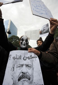 Hundreds of demonstrators marched to protest against the Islamist party Ennahda in power, and demanded that Belaid's killers be found. (AFP Photo)