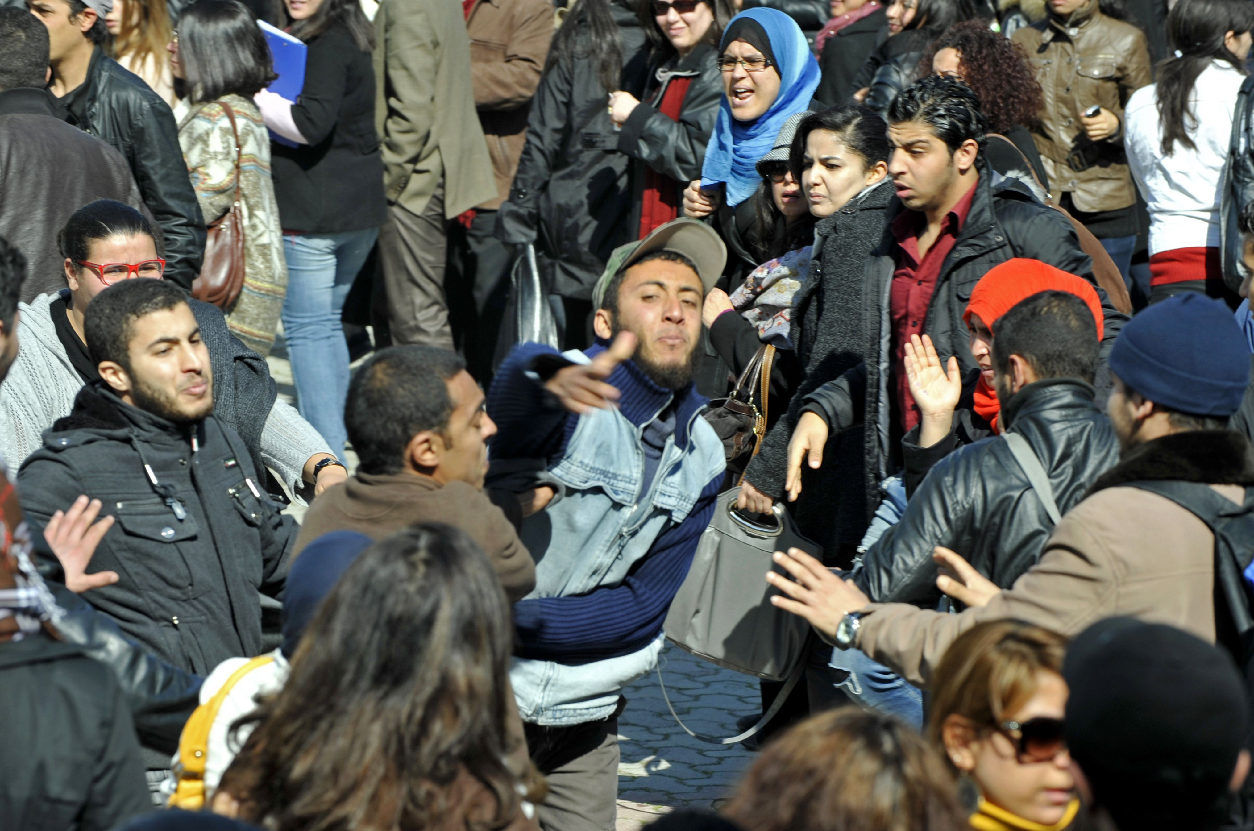"Islamist students attack students of the Bourguiba Language Institute in the El Khadra neighbourhood, a Salafist bastion, of the capital Tunis, as they try to prevent the filming of current Internet craze the ""Harlem Shake"" (AFP Photo )"