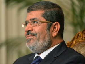 "In response to questions on whether the Muslim Brotherhood influences his presidential decisions, Morsi said that his ""background with the Brotherhood is part of my psychology, humanity and belief"". (AFP Photo)"