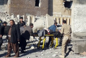 Iraqi rescuers wheel a gurney from the scene after an attack on a police headquarters in Kirkuk, on February 3, 2013 (AFP/File, Marwan Ibrahim)