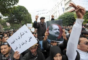 Tunisian protesters hold placards during a demonstration on 23 February on the Habib Bourguiba Avenue in Tunis, demanding that opposition leader Chokri Belaid's killers be found (AFP Photo / Fethi Belaid)