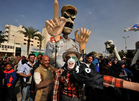 Egyptian protesters hold an effigy depicting President Mohamed Mursi while shouting slogans during an anti-government demonstration in the canal city of Port Said last Friday (AFP Photo / Stringer)