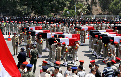 Funeral of Egyptian border guards killed last August (AFP Photo)