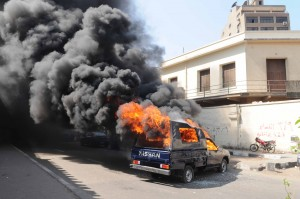 The angry crowd also launched several fireworks, two of them over the police building's wall, and eventually smashed and set fire to an empty police truck parked outside. (Photo By Ahmed El-Malky)