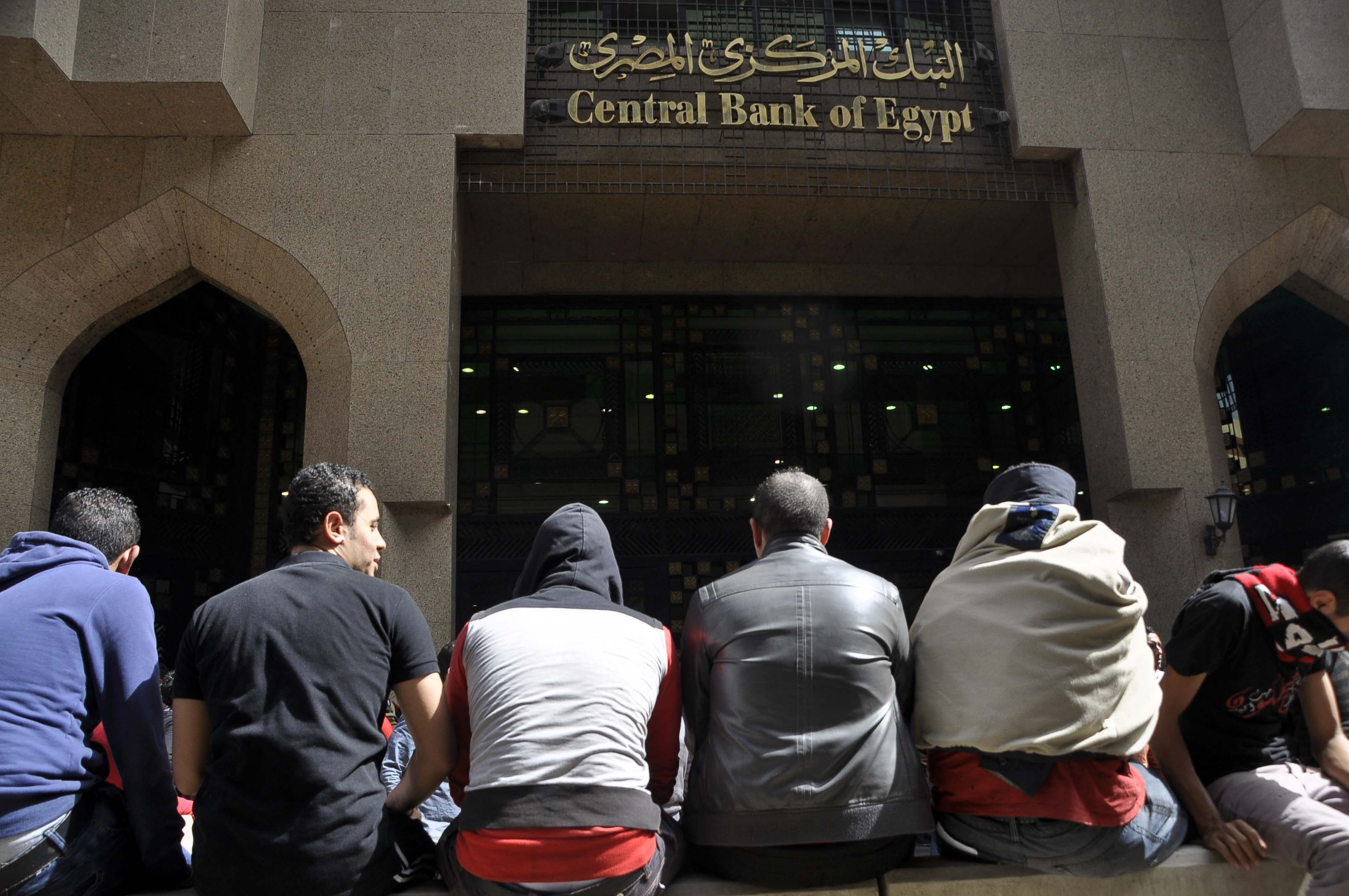 The Ultras surrounded the Central Bank of Egypt in Downtown Cairo early on Sunday preventing employees from entering the building. They also blocked the road to the Cairo International Airport. (Photo by Ahmed El- Malky)