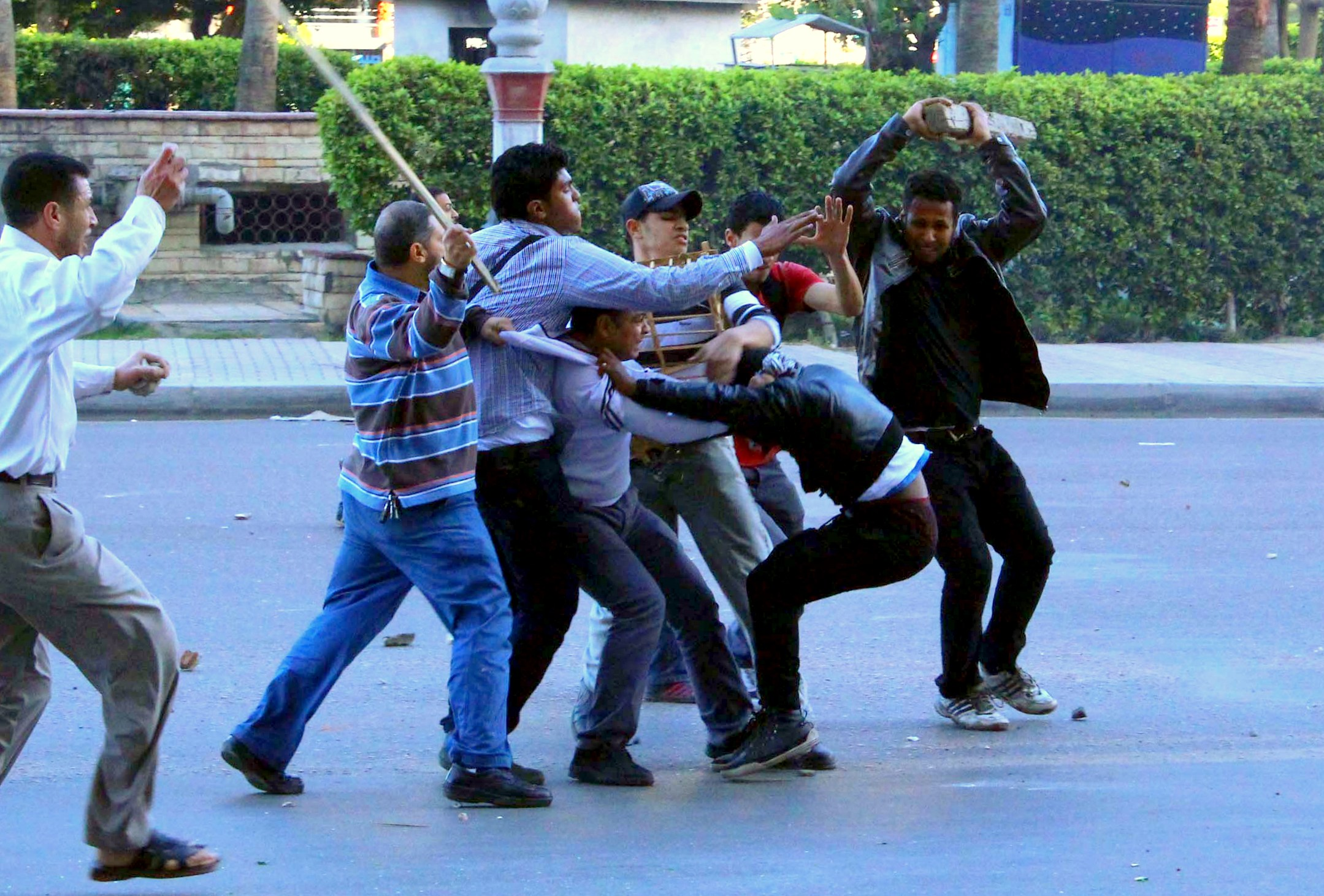 Members of the Muslim Brotherhood seize an opposing protester during clashes in Alexandria (Photo By: Ahmed Arab)