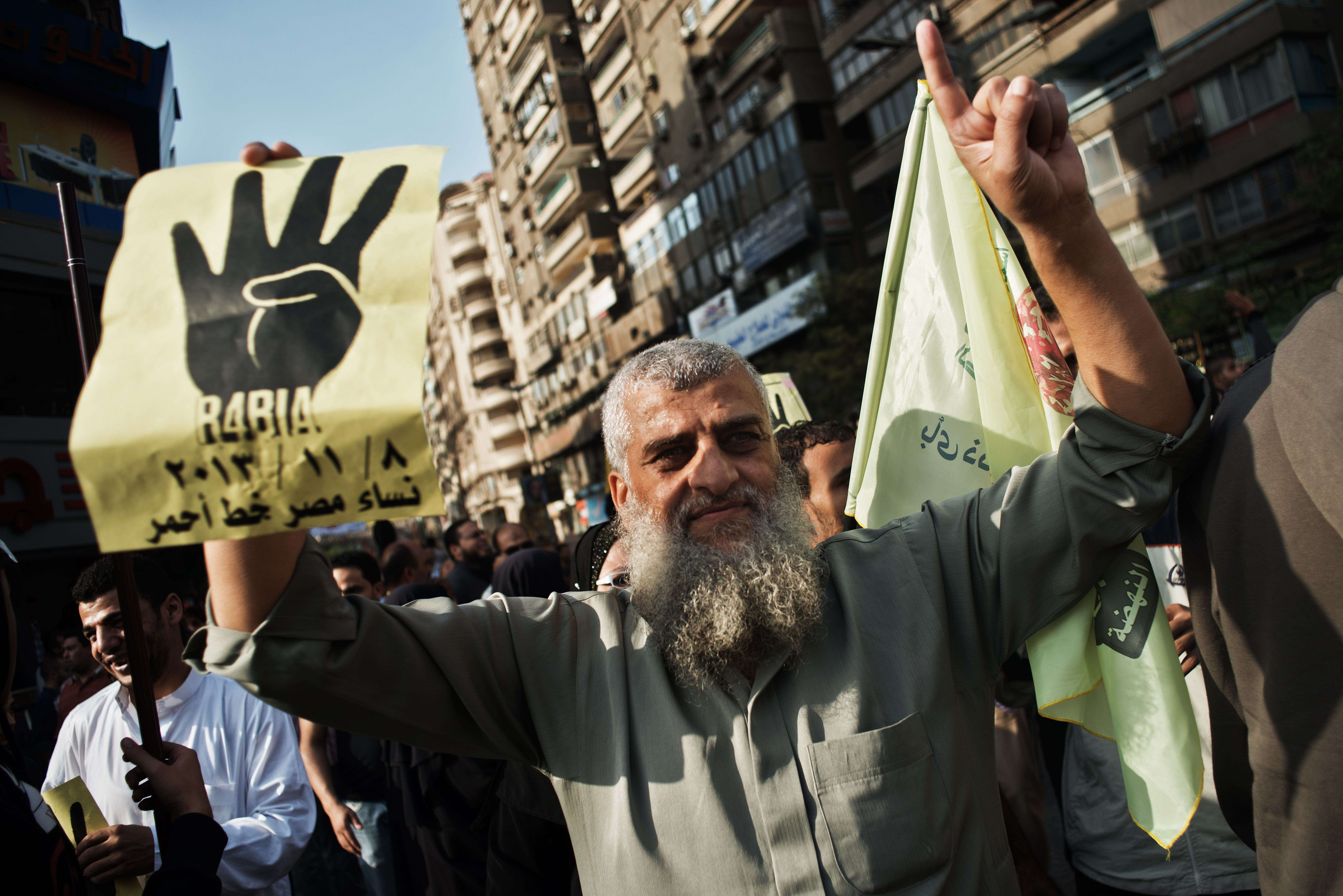Thousands of supporters of the Muslim Brotherhood and ousted president Mohamed Morsi march through the streets of Cairo in his support on November 8, 2013 in Cairo.  (AFP PHOTO/GIANLUIGI GUERCIA)
