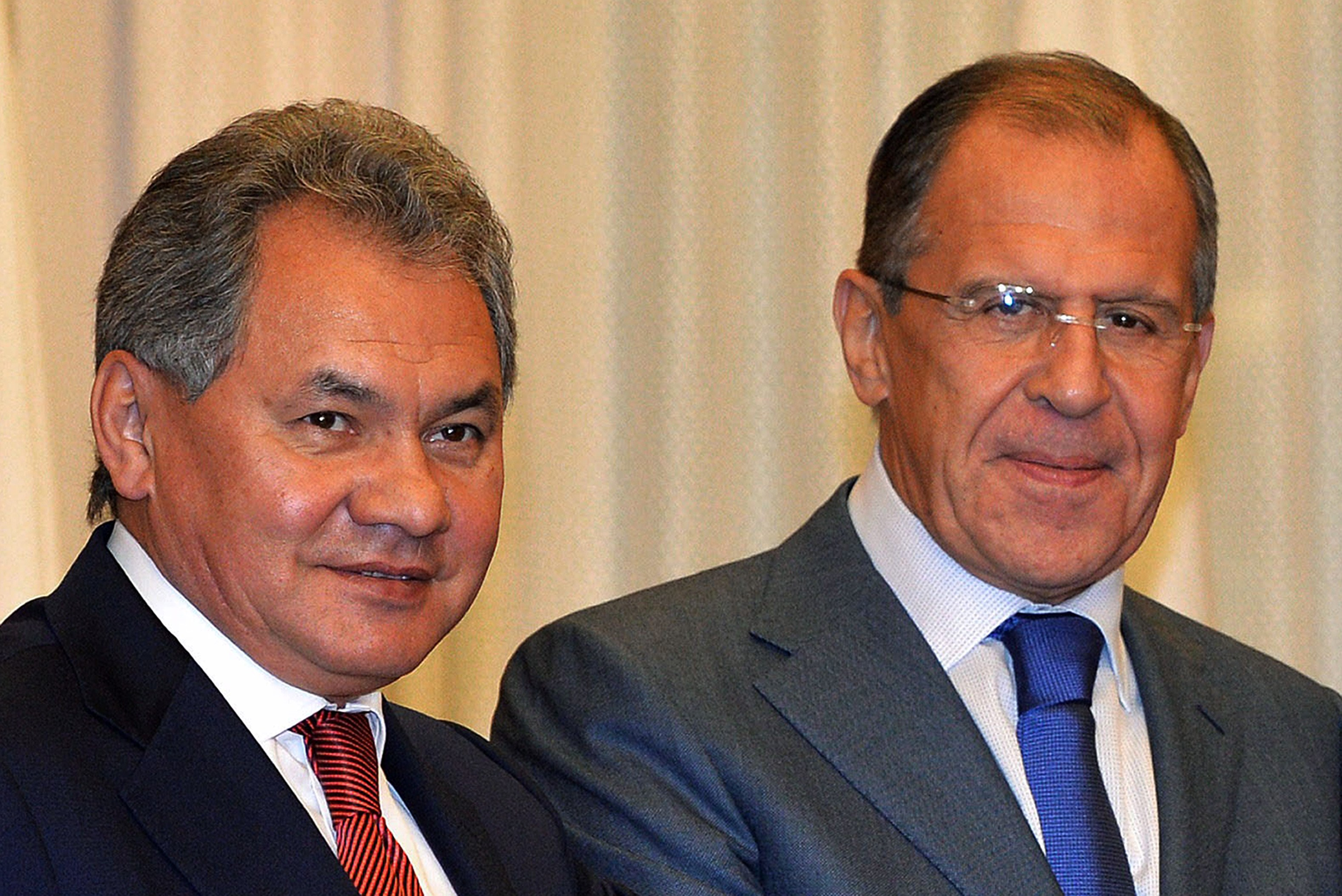 A file picture taken on November 2, 2013, shows (L-R) Russia's Defence Minister Sergei Shoigu and Foreign Minister Sergey Lavrov smiling during their visit to Tokyo.  (AFP PHOTO / POOL / Yoshikazu TSUNO)
