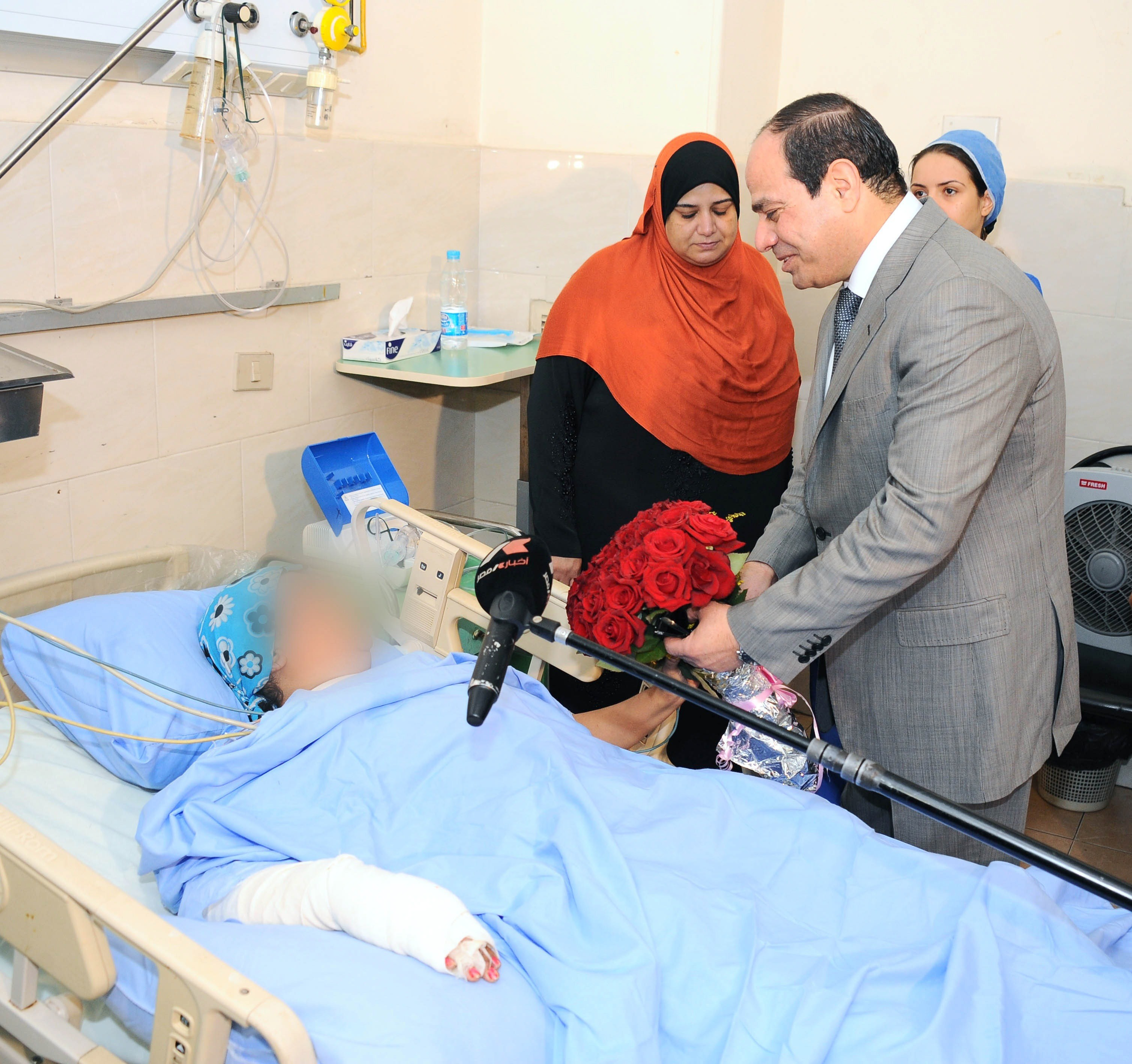 "A handout picture released  by the Egyptian presidency on June 11, 2014, shows newly elected president Abdel Fattah al-Sisi visiting a hospital where the victim of a sexual assault is receiving treatment. Egypt, which until this month had no specific law on sexual harassment, last week approved penalties for such offences to include jail terms, fines or both. Sisi has instructed the interior minister Mohamed Ibrahim to ""implement the law firmly"" to prevent sexual harassment. (AFP PHOTO / HO / EGYPTIAN PRESIDENCY)"