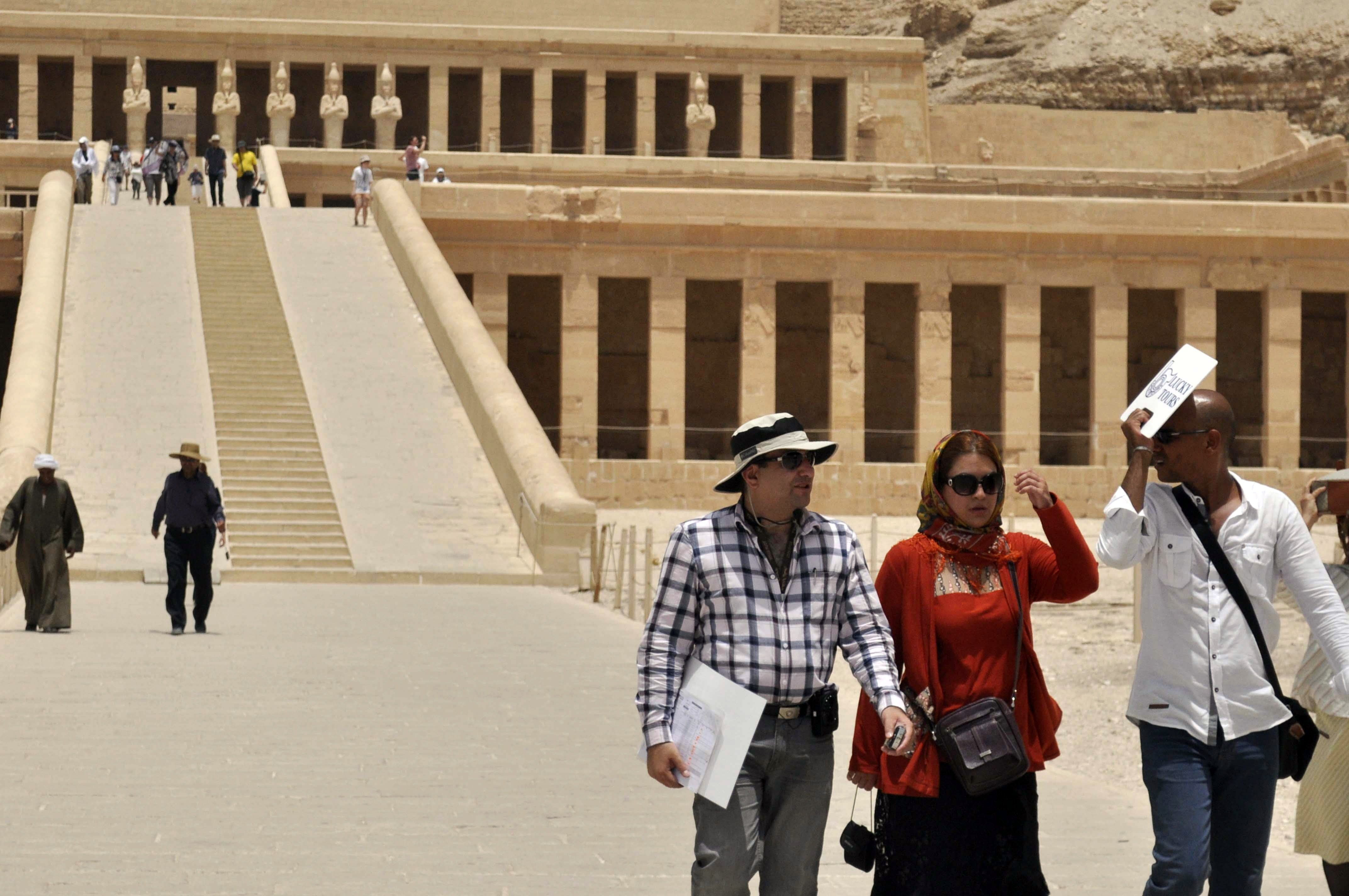 Iranian tourists visit the Temple of Hatshepsut in Luxor on June 3, 2013, during the second visit by Iranian tourists to Egypt in over thirty years. (AFP Photo)