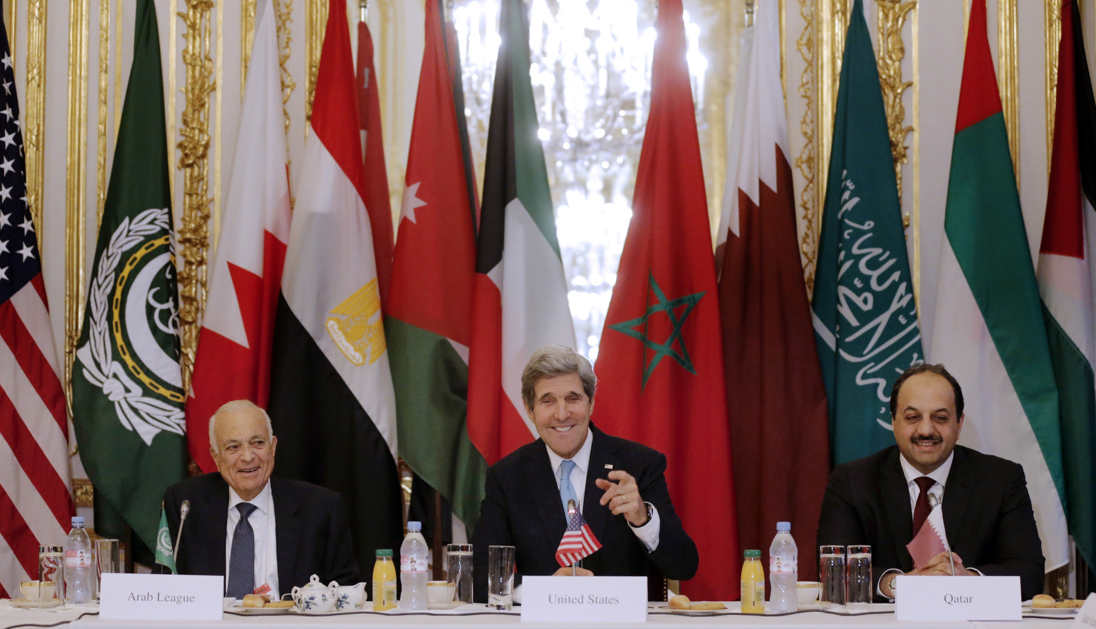 "U.S. Secretary of State John Kerry (C), Qatar's Foreign Minister Khalid bin Mohamed al-Attiya (R) and Arab League Secretary General Nabil Alarabi attend a meeting dedicated to the conflict in Syria at the U.S. embassy in Paris ahead of a gathering of the 'Friends of Syria' group, on January 12, 2014. Ahmad Jarba, the leader of Syria's opposition National Coalition, said today that the US-led ""Friends of Syria"" grouping had agreed that President Bashar al-Assad and his family will have no role in the country's future.  (AFP PHOTO / POOL / Christian Hartmann)"