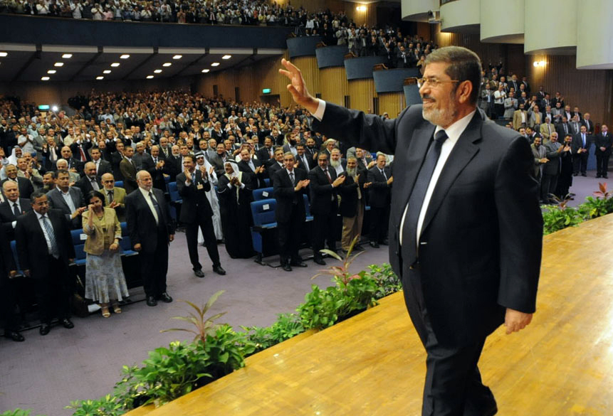 A handout picture released by the Egyptian presidency shows Egyptian President Mohamed Morsi waving to the audience prior to giving a speech during a conference on protecting the country's water crisis and Ethiopia's dam project on the Blue Nile in Cairo on June 10, 2013. (AFP Photo)