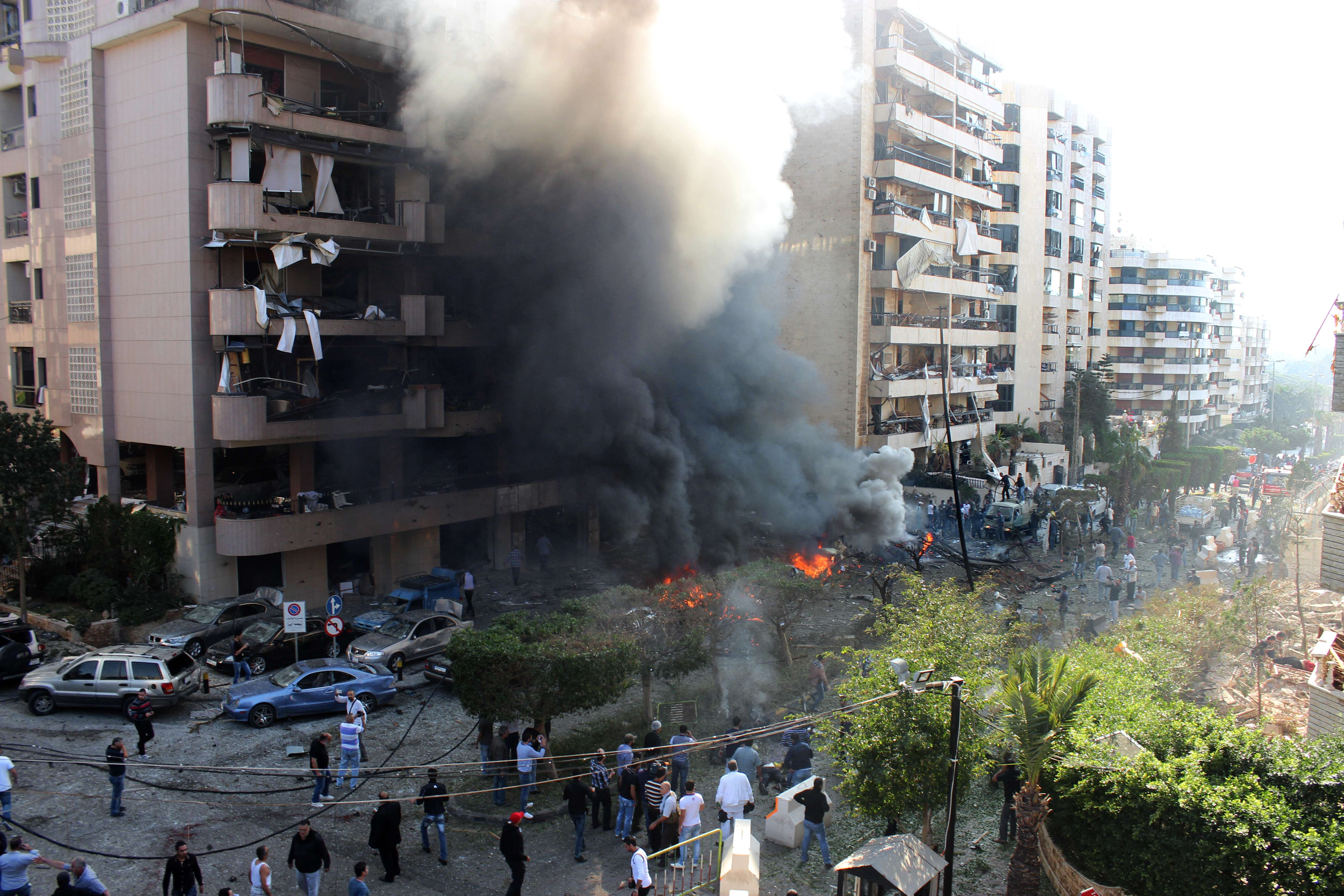 Flames rise from the site of a blast in Bir Hassan neighbourhood in the southern Beirut on 19 November  2013. AFP PHOTO