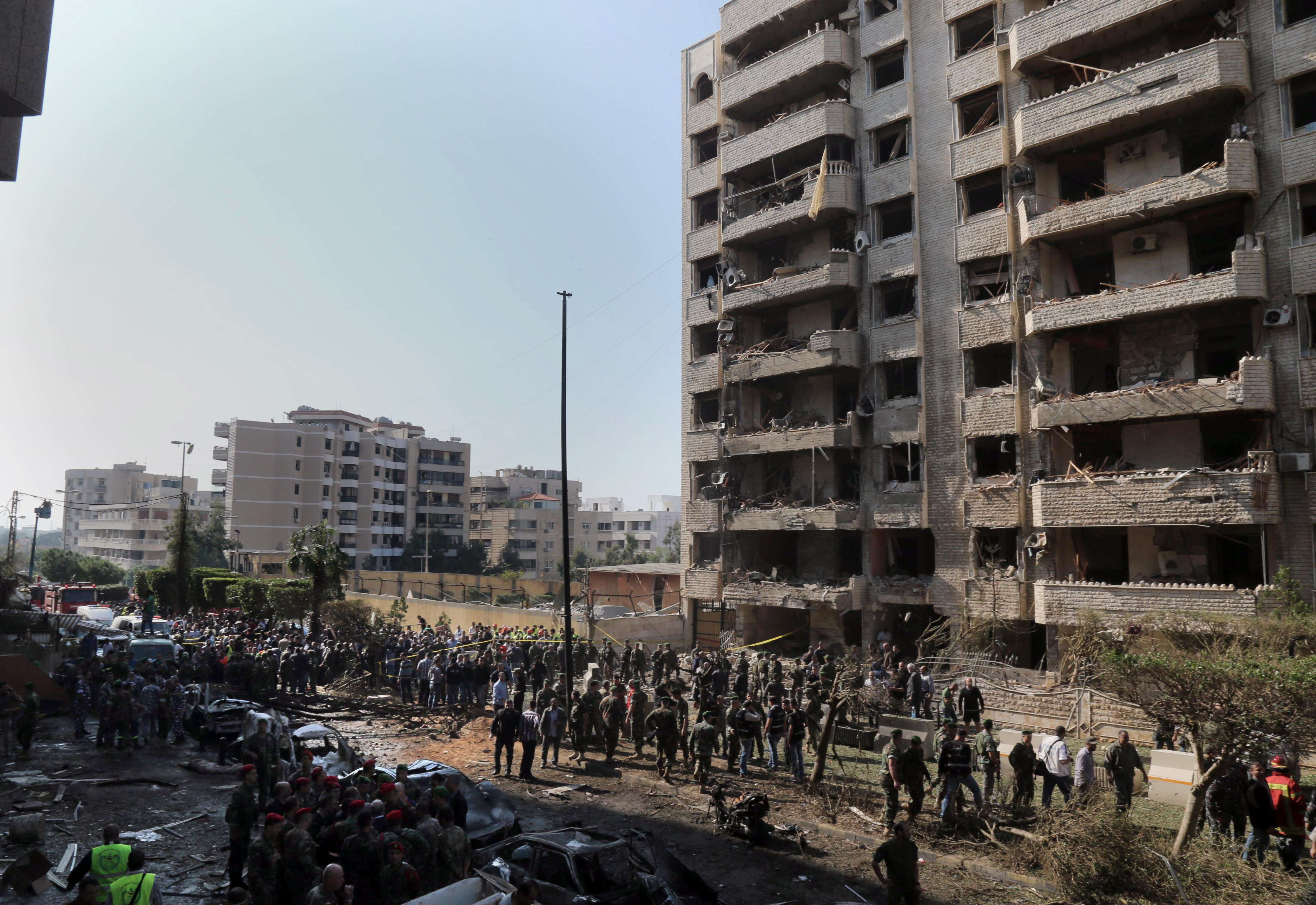 People gather at the site of a blast in Bir Hassan neighbourhood in southern Beirut.  AFP PHOTO