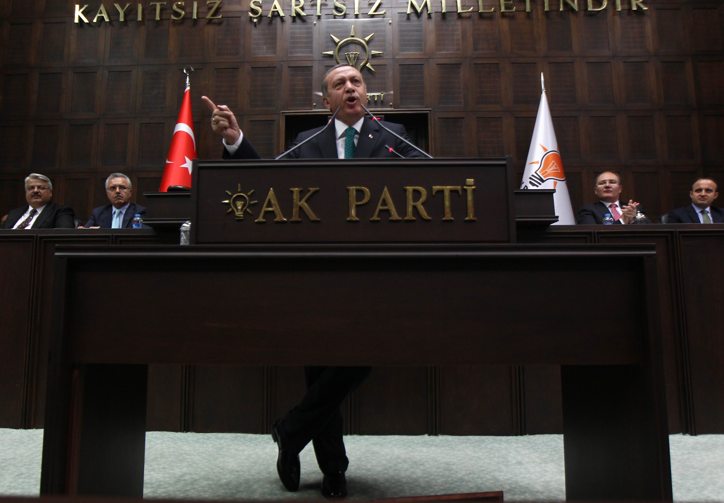 Turkey's Prime Minister Recep Tayyip Erdogan addresses members of the parliament of his ruling AK Party (AKP) during a meeting at the Turkish Parliament in Ankara on June 24, 2014.  (AFP PHOTO/ADEM ALTAN)