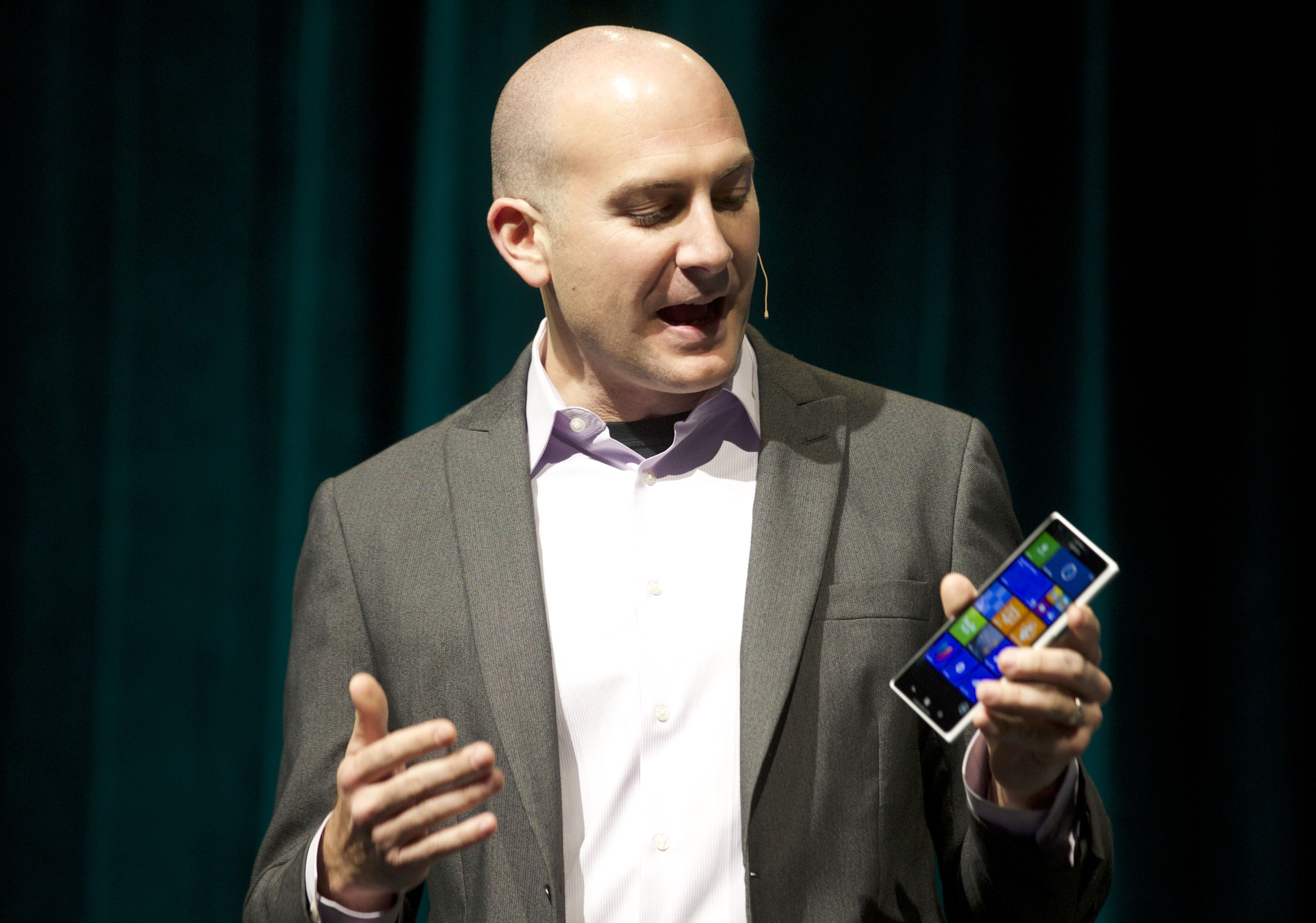 Microsoft Executive Communications Manager Ryan Asdourian demonstrates a six-inch Nokia phablet running Windows software during the Microsoft Shareholders Annual Meeting November 19, 2013 in Bellevue, Washington. Asdourian demonstrated several devices running windows operating systems and software.  (Stephen Brashear/Getty Images/AFP)