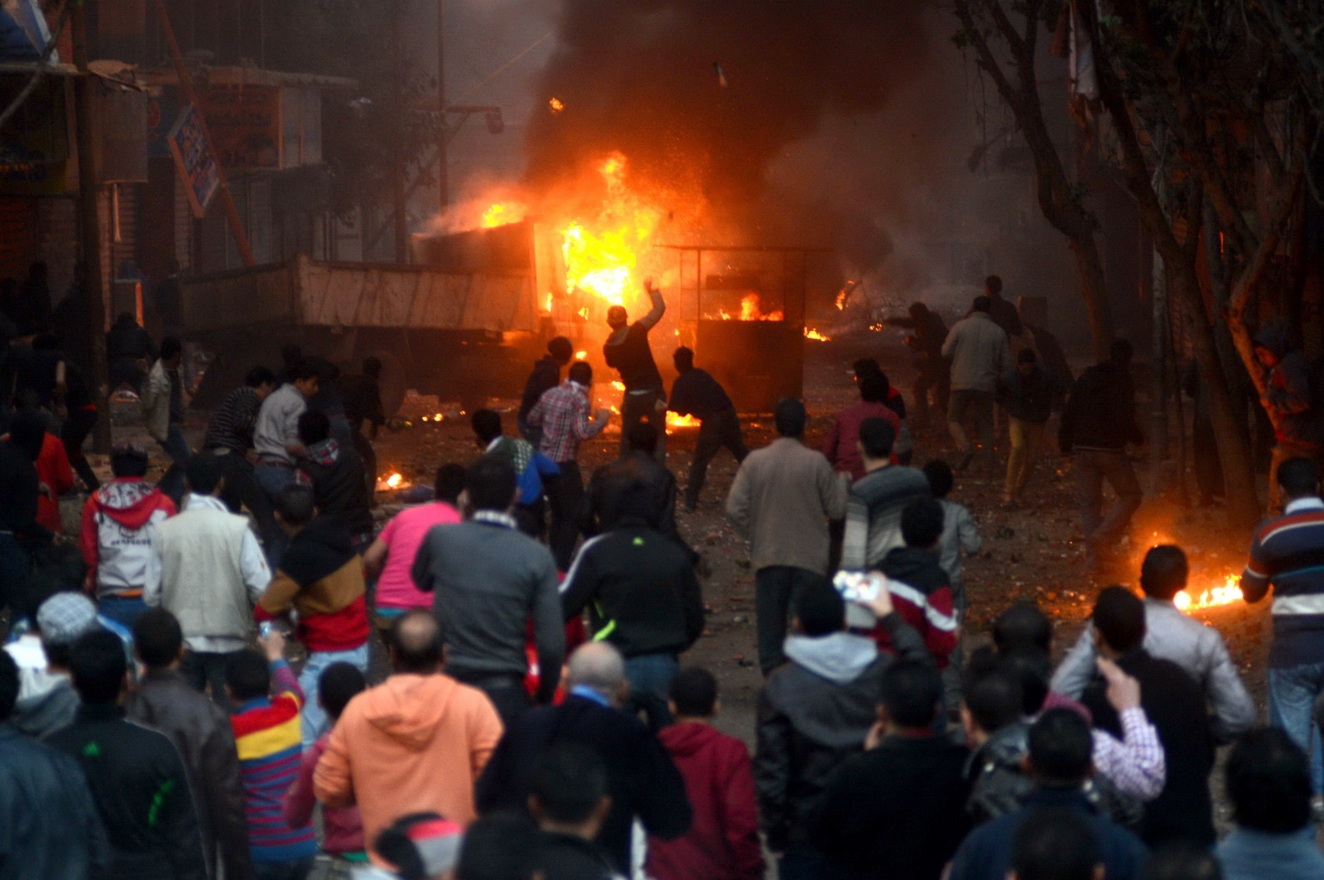 Supporters of the Muslim Brotherhood clash with civilians and Egyptian riot police in Alf Masskan district in the capital Cairo on January 17, 2014. At least one person was killed in clashes between Egyptian police and Islamists, as the country awaited results of a constitutional referendum billed as an endorsement of president Mohamed Morsi's overthrow.  (AFP PHOTO / AHMED GAMEL)