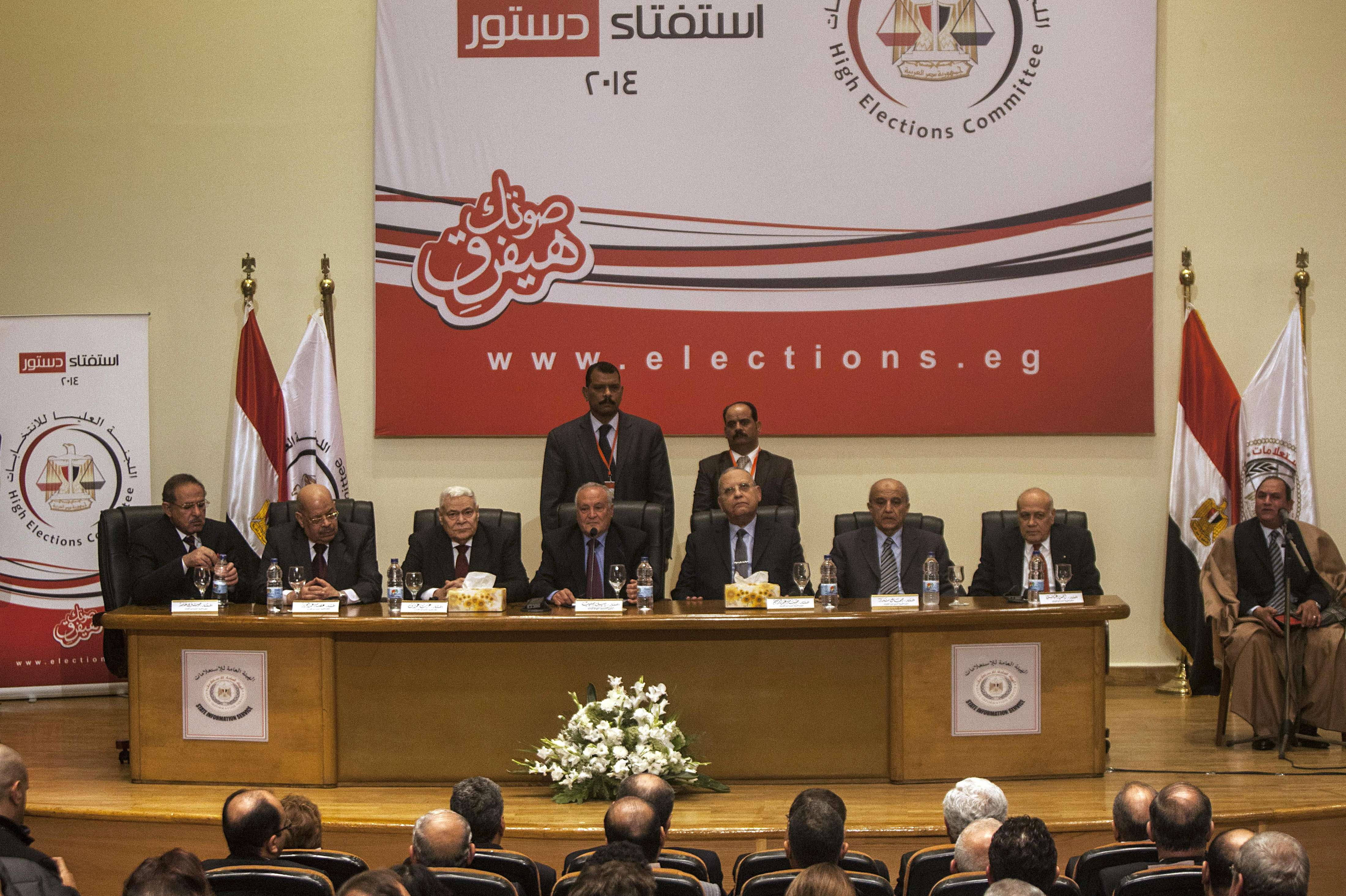 Head of Egypt's High Election Commission, Judge Nabil Salib (C) heads a press conference to announce the voting results of a referendum on January 18, 2014 in Cairo. Egyptian voters have approved a new constitution by 98.1 percent, Salib said, in what the government declared a popular endorsement of the army's overthrow of Islamist president Mohamed Morsi.      (AFP PHOTO MAHMOUD KHALED)