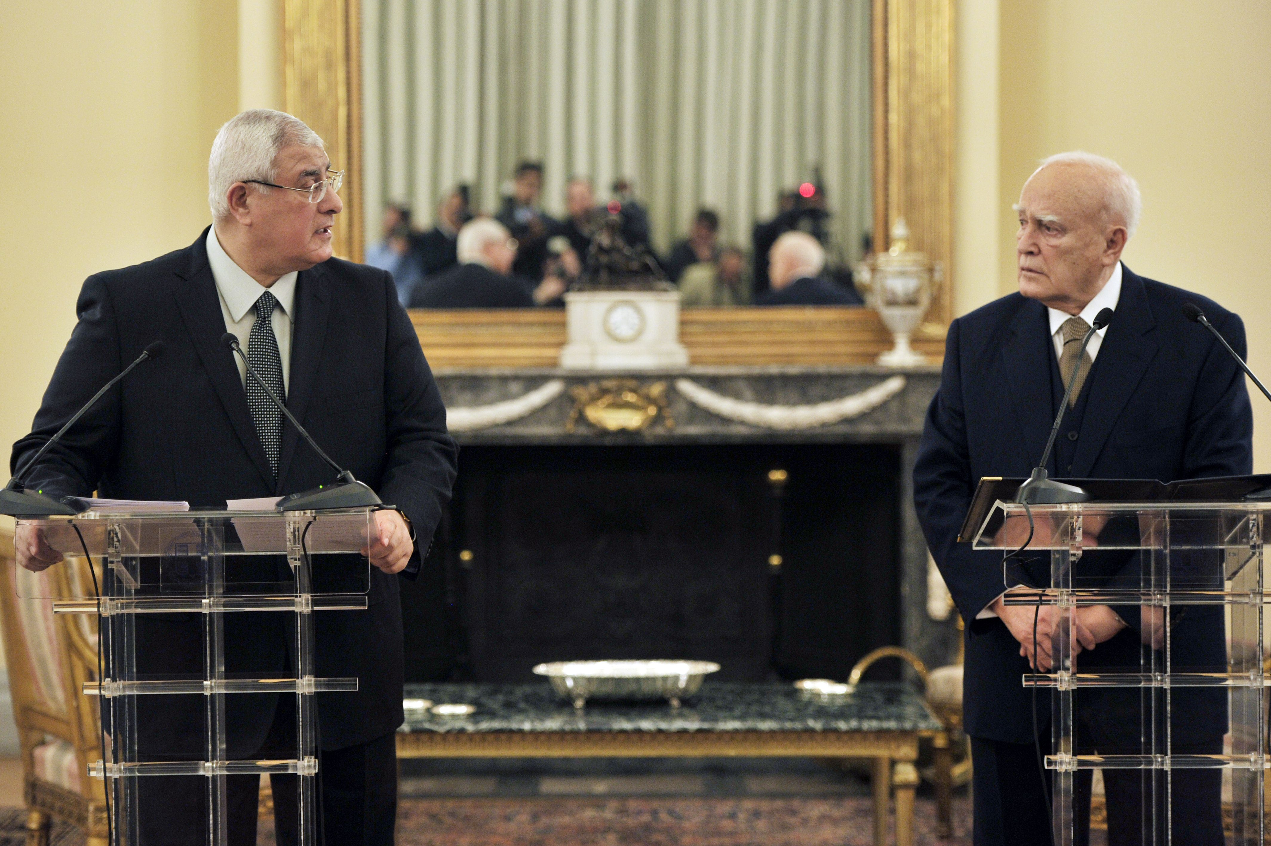 Interim President of Egypt , Adly Mansour (L)  and  Greek president Carolos Papoulias make statements to the press after their talks at the Presidental palace   in Athens on January 20, 2014. The Egyptian president arrived in Athens for a working visit.   (AFP PHOTO / LOUISA GOULIAMAKI)