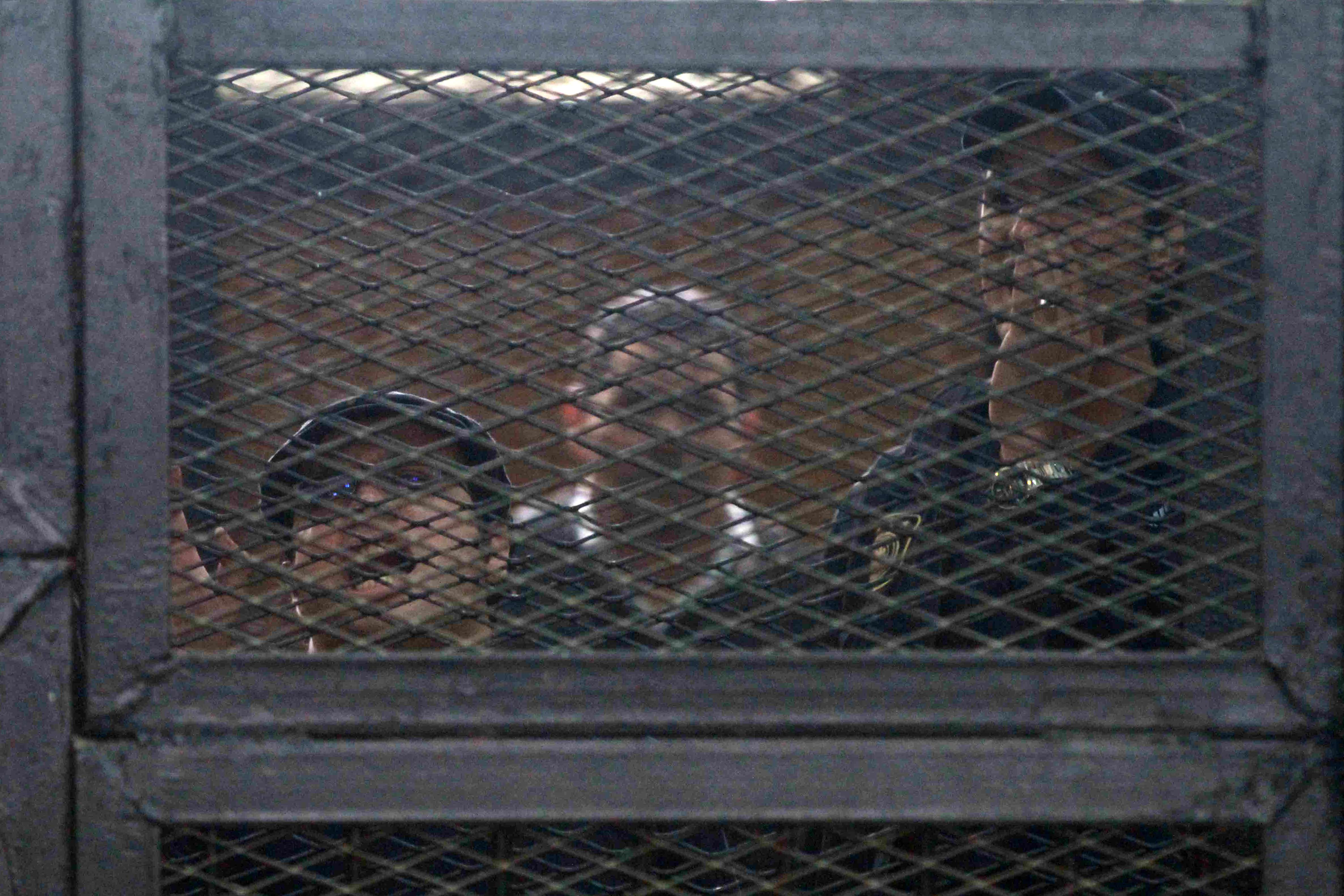 Egyptian prominent activists Ahmed Douma (Right) and Ahmed Maher (left), react as they stand in the accused dock during their trial in the capital Cairo on Monday.  (AFP Photo)