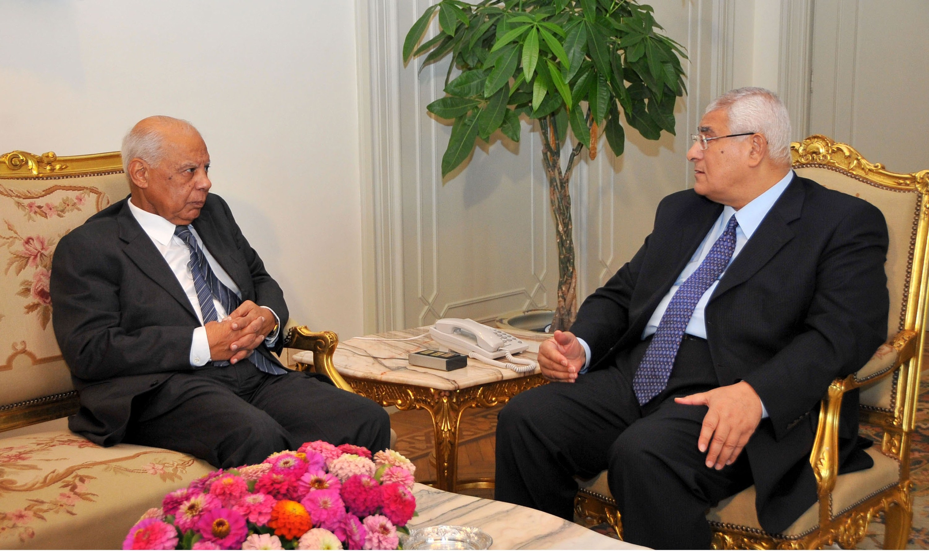 Egypt's interim president Adly Mansour (R) meeting with new-appointed Prime Minister Hazem al-Beblawi (AFP PHOTO / EGYPTIAN PRESIDENCY)